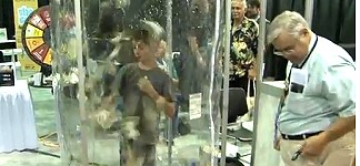 Kid Fun in the Cash Cube at ANA World's Fair of Money. VIDEO: 2:59.