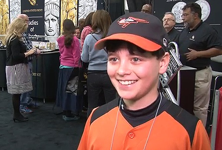Young Collector Buys First Baseball Commemorative Coin. VIDEO: 2:01