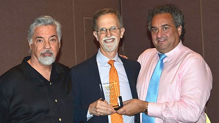 Steve Ivy (center) is inducted into the PCGS CoinFacts Coin Dealer Hallof Fame by David Hall (left), Co-Founder of PCGS, and Kevin Lipton (right) on August 8, 2014 at the ANA World's Fair of Money.  (Photo by Donn Pearlman.)