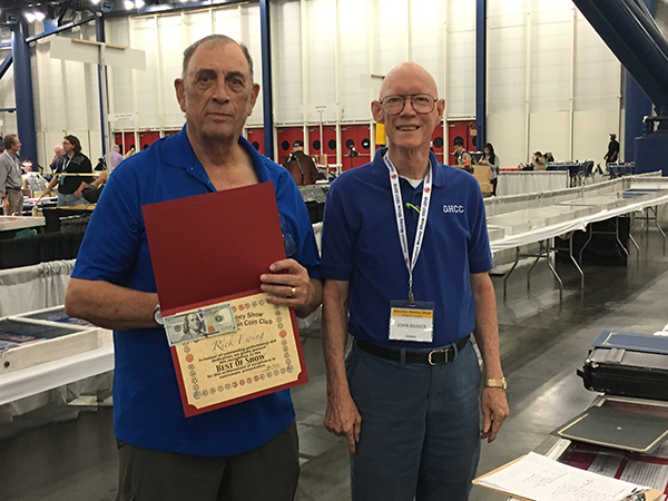 Rick Ewing (L) accepts Best in Show Award from Exhibit Chairman, John Barber.