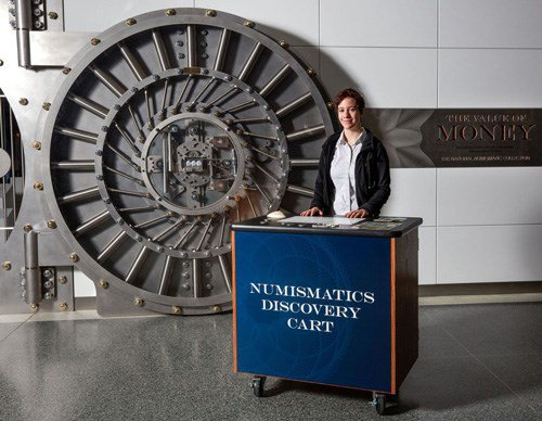 The Discovery Cart outside of the new exhibit of the Smithsonian National Numismatic Collection. Photo courtesy NGC