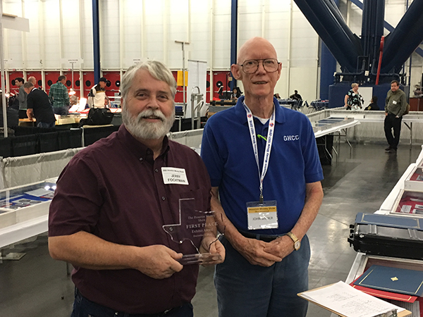 Jerry Fochtman (L) accepts an exhibit award from John Barber. Photo courtesy GHCC