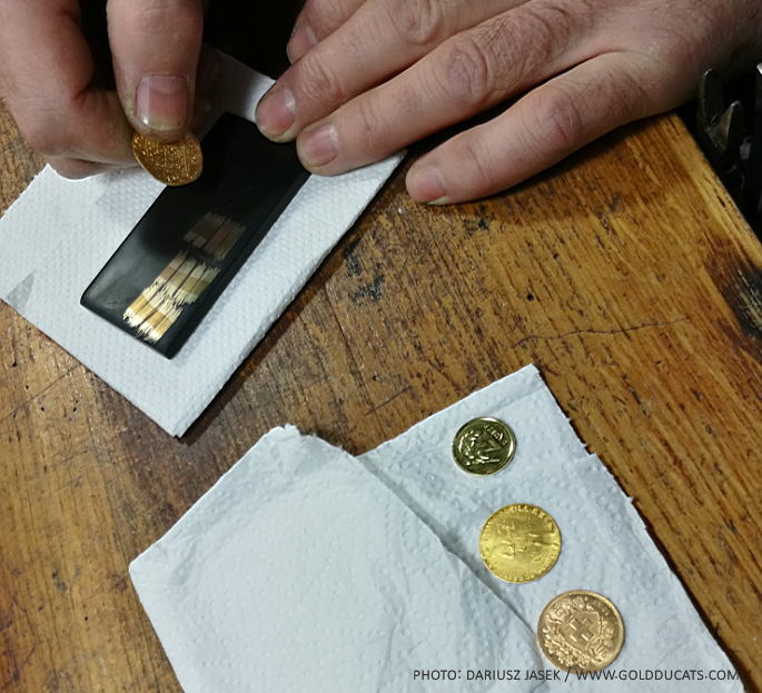 Testing coins using a touch stone and karat needles. Image courtesy Dariusz F. Jasek