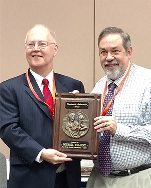 David harper presents Michael Fuljenz with a 2017 Numismatic Ambassador award at the January FUN Show.