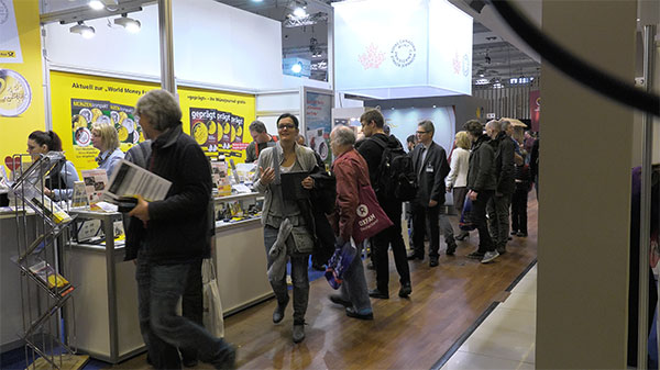 A crowd gathers at the German Post Office Booth at the Berlin World's Money Fair in 2017