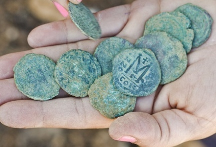 Bronze Byzantine coins discovered in Israel. Photo courtesy Yoli Shwartz | © Israel Antiquities Authority (IAA)