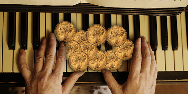Gold Coins on Piano - News Wire